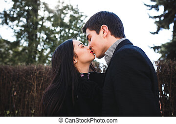 couple in the park - beautiful girl and her boyfriend met in...