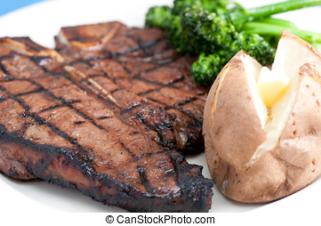 t-bone steak - a delicious t-bone steak grilled to...