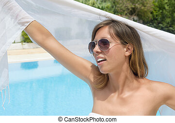 Happy girl waving white scarf at the swimming pool - Happy...