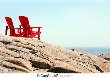 Red chairs by the sea - Pair of red chairs by the sea,...