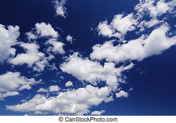 Sky and clouds - Blue sky with the fluffy white clouds,...