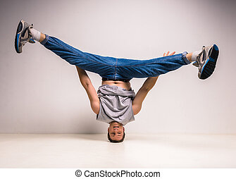 Breakdancer - Handsome break dancer standing on his head at...