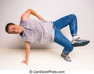 Breakdancer - Young and beautiful breakdancer posing at...