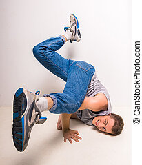 Breakdancer - Skilful breakdancer posing on his hands at...