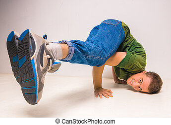 Breakdancer - Young guy breakdancing at studio over white...