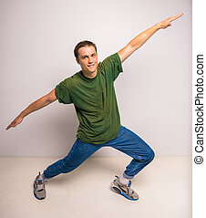 Breakdancer - Handsome breakdancer standing at studio on...