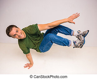 Breakdancer - Skilful breakdancer doing moves while...