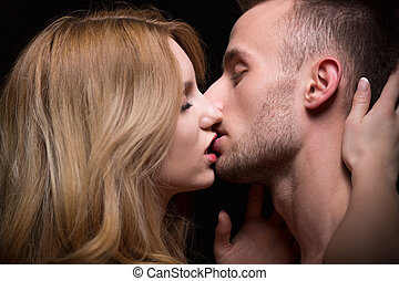 Couple kissing with passion - Close-up of naked couple...