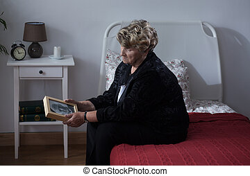 Lonely woman in rest home - Lonely woman being in mourning...