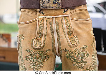Green manual embroidery on deerskin leather trousers -...