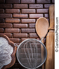 Top view of wooden spoon bowl flower sieve rolling-pin...