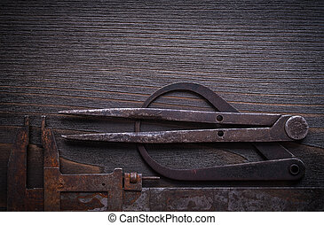 Longstanding calipers on vintage wooden background...