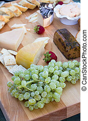 assorted cheese plate table with fruits