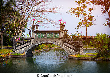 Ornate Bridge with Dragon Motif at Tirta Gangga in Indonesia...