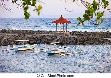Traditional Boats Anchored off a Stone Jetty in Bali, Indonesia