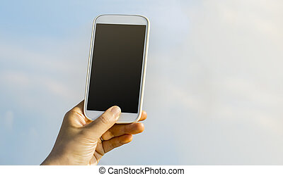 Person holding a smartphone to the sky