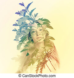 Young woman with abstract leaves - Portrait of young woman...