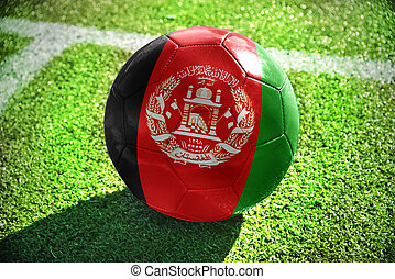 football ball with the national flag of afghanistan lies on...