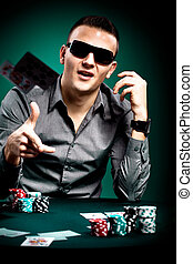 poker player - a young man playing poker