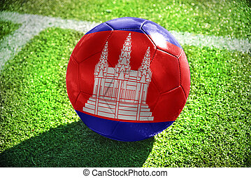 football ball with the national flag of cambodia lies on the...