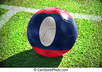football ball with the national flag of laos lies on the...