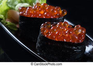 Salmon roe - Ikura sushi , ikura with seaweed (Nori),...