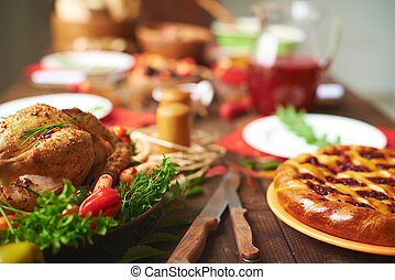 Thanksgiving dinner - Appetizing pie and roasted chicken on...