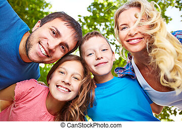 Cheerful family - Happy faces of four family members