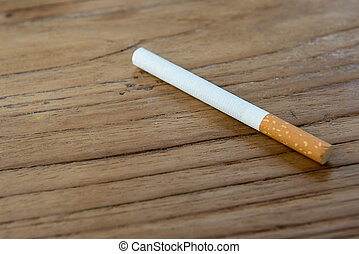 cigarette on wooden table