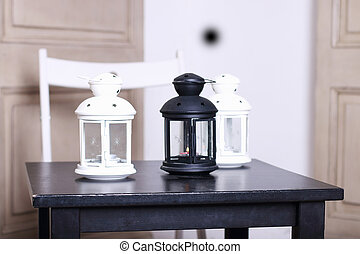 Three luminaire on black wooden table - Three luminaire two...