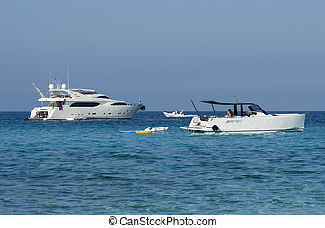 Launches and yachts moored off on a blue sea - Some...