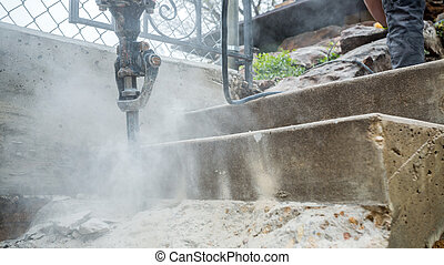 Jackhammer in action - Jackhammer working on the...