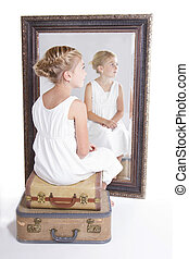 Child or young girl in front of a mirror, sitting on vintage...