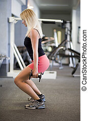 squat - blond woman trains her legs