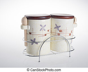 Tea coffee and sugar cannisters isolated against on white...