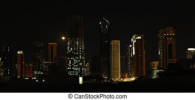Doha towers and Moon - A panoramic view of some of the...