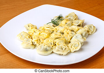 Russian dumplings with cheese sause served dill branch