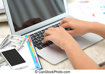 Business woman hand typing on laptop keyboard with Financial...