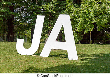 Yes Ja, white letters - German Yes Ja written with upper...