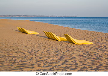 Beach chairs and rescue boat