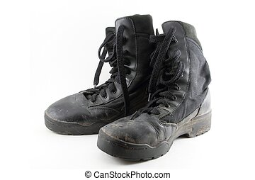 Combat Boots - A pair of black, worn combat boots isolated...