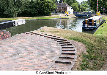 Wide beamed boat on the Kennet and Avon Canal near...
