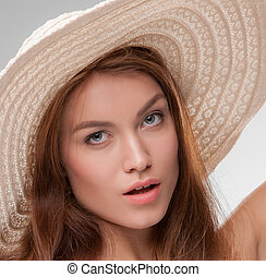 Beautiful girl with broad-brim - Close-up portrait of...
