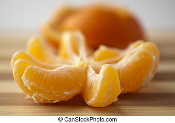 Mandarin - Closeup of cloves of a mandarin, peel on the...