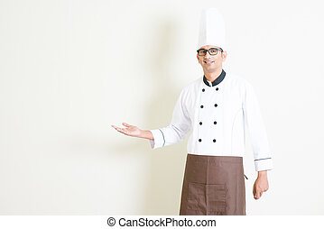 Indian male chef in uniform welcoming - Portrait of handsome...