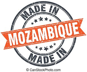 Mozambique orange grunge ribbon stamp on white