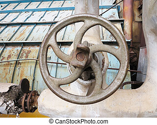 Old rusty industrial pipe valve for hot water at power plant