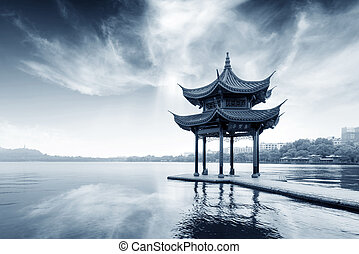 hangzhou - chinese ancient pavilion on the west lake in...