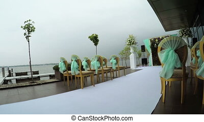 Weddings ceremony at river - Camera on steadicam flies under...