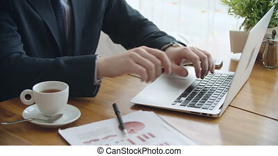 Business Hands Working - Hands of businessman working on...